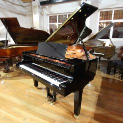 Brand new Yamaha C6 grand piano, in a black polyester case, for sale.
