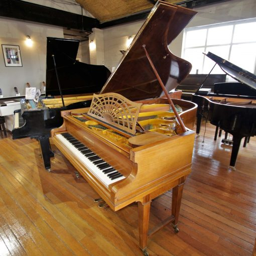 Bechstein Model B boudoir grand piano on gated legs with a rosewood case