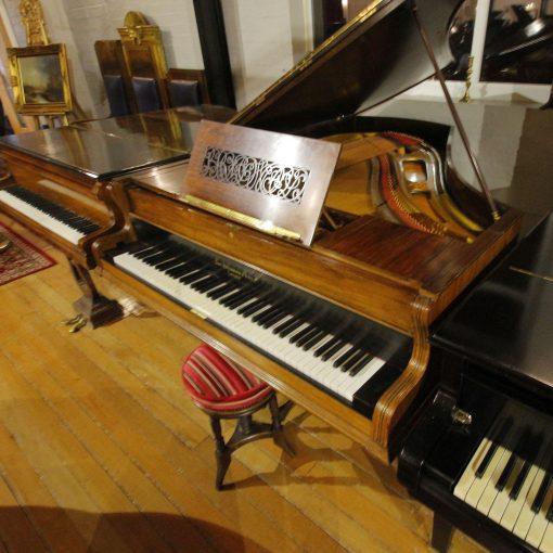 Broadwood barless boudoir grand piano in a rosewood case