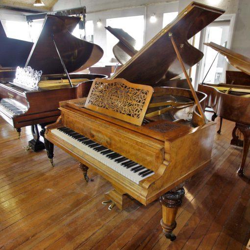 Hagspiel baby grand piano in burr walnut case