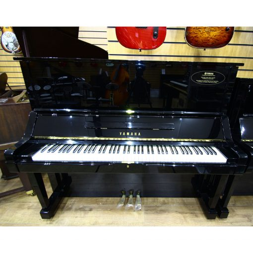 Yamaha certified refurbished U3 upright piano, in a black case, for sale.