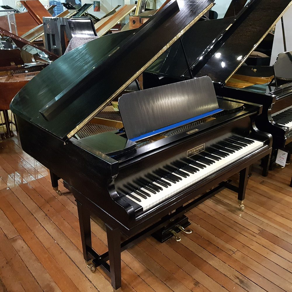Hopkinson baby grand piano for sale, finished in a black case.