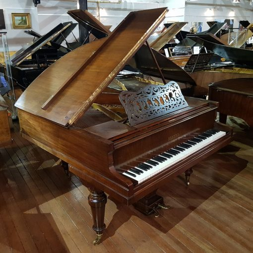 Pleyel baby grand piano in a rosewood case for sale.
