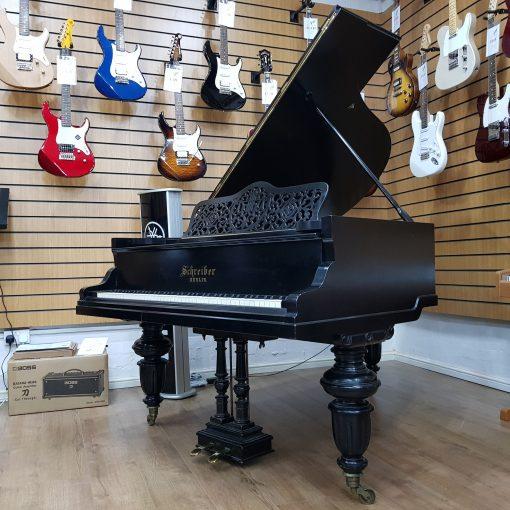 Schrieber boudoir grand piano, in a black case, for sale.