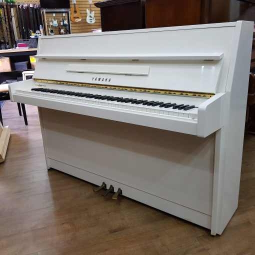 Yamaha M108 Upright Piano, in a white polyester case, for sale.