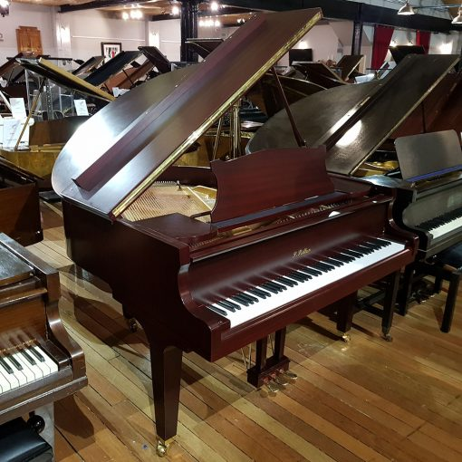Used Ritter baby grand piano, in a satin plum mahogany case for sale.