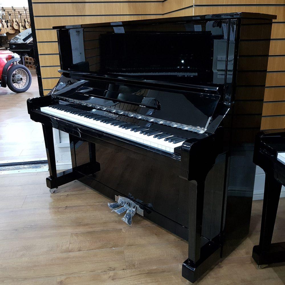 Steinhoven SU-131 upright piano, in a black polyester case, for sale.