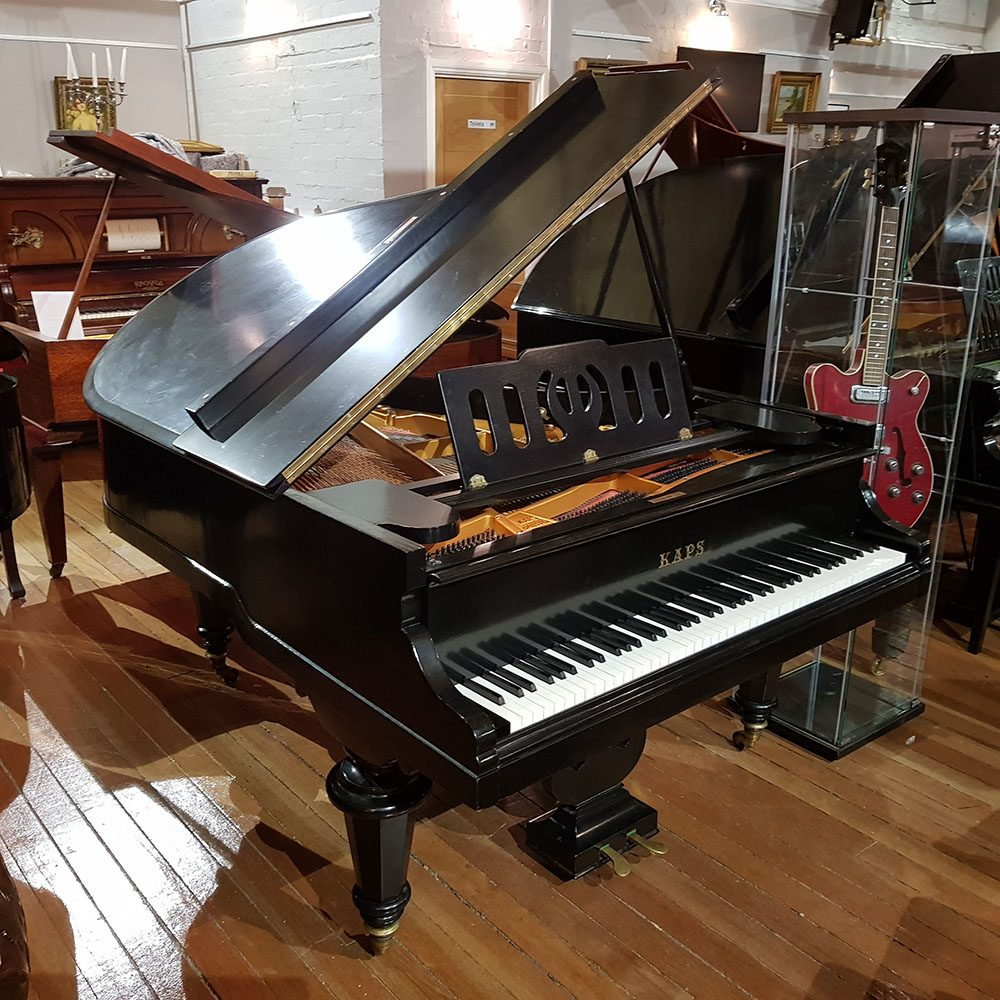 Used Ernst Kaps baby grand piano, in a black lacquer case for sale.