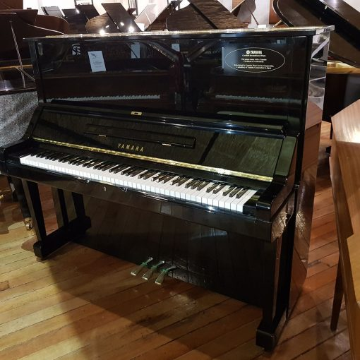 Used Yamaha UX upright piano, in a black polyester case, for sale