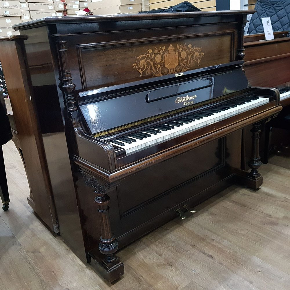 Used Bluthner upright piano, in a rosewood case, for sale.