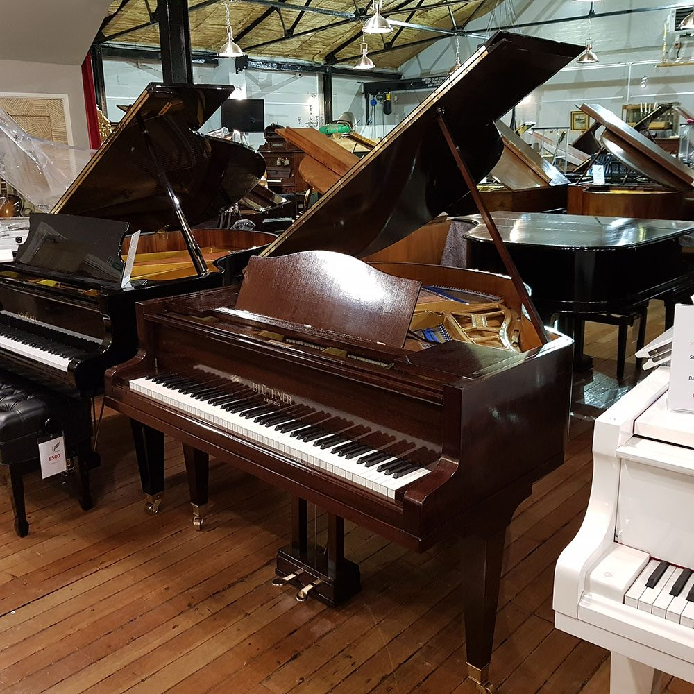 Restored Bluthner Style 4 baby grand piano, in a mahogany case, for sale.