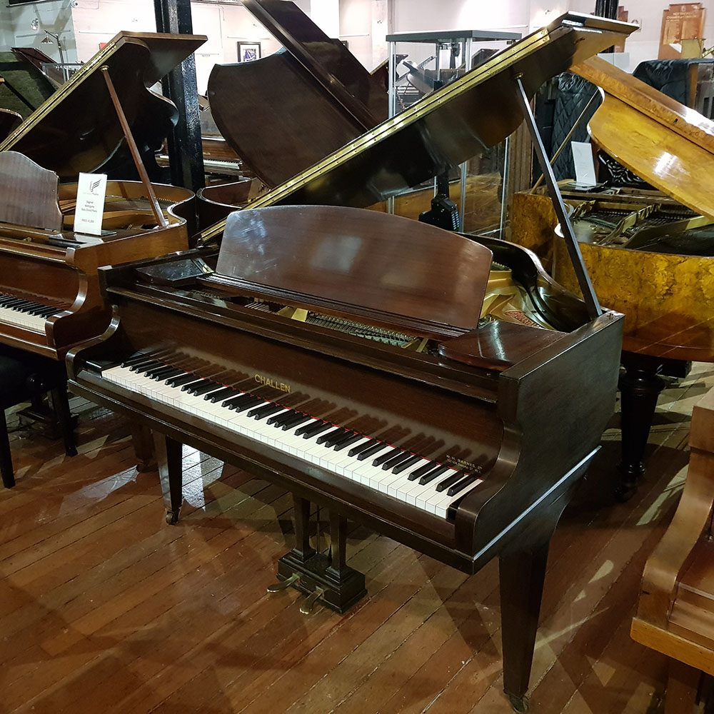 Used challen baby grand piano finished in a mahogany case, for sale.