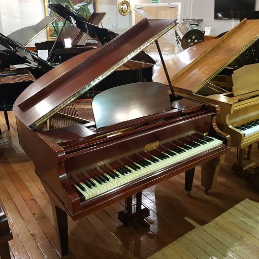Kirkman Baby Grand Piano, finished in a mahogany case, for sale.