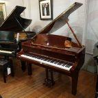 New Steinhoven GP148 baby grand piano, in a walnut case for sale.