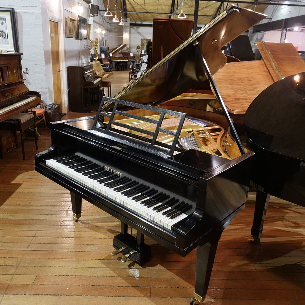 Restored Bluthner Style 4a baby grand piano, in a black case, for sale.