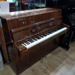 Reid Sohn S108 Upright Piano, in a walnut case, for sale.