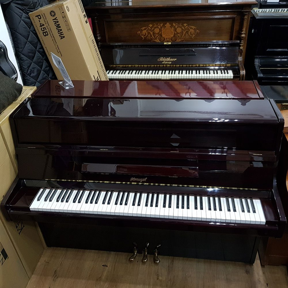 Horugel SU-108 upright piano for sale, in a rosewood case.