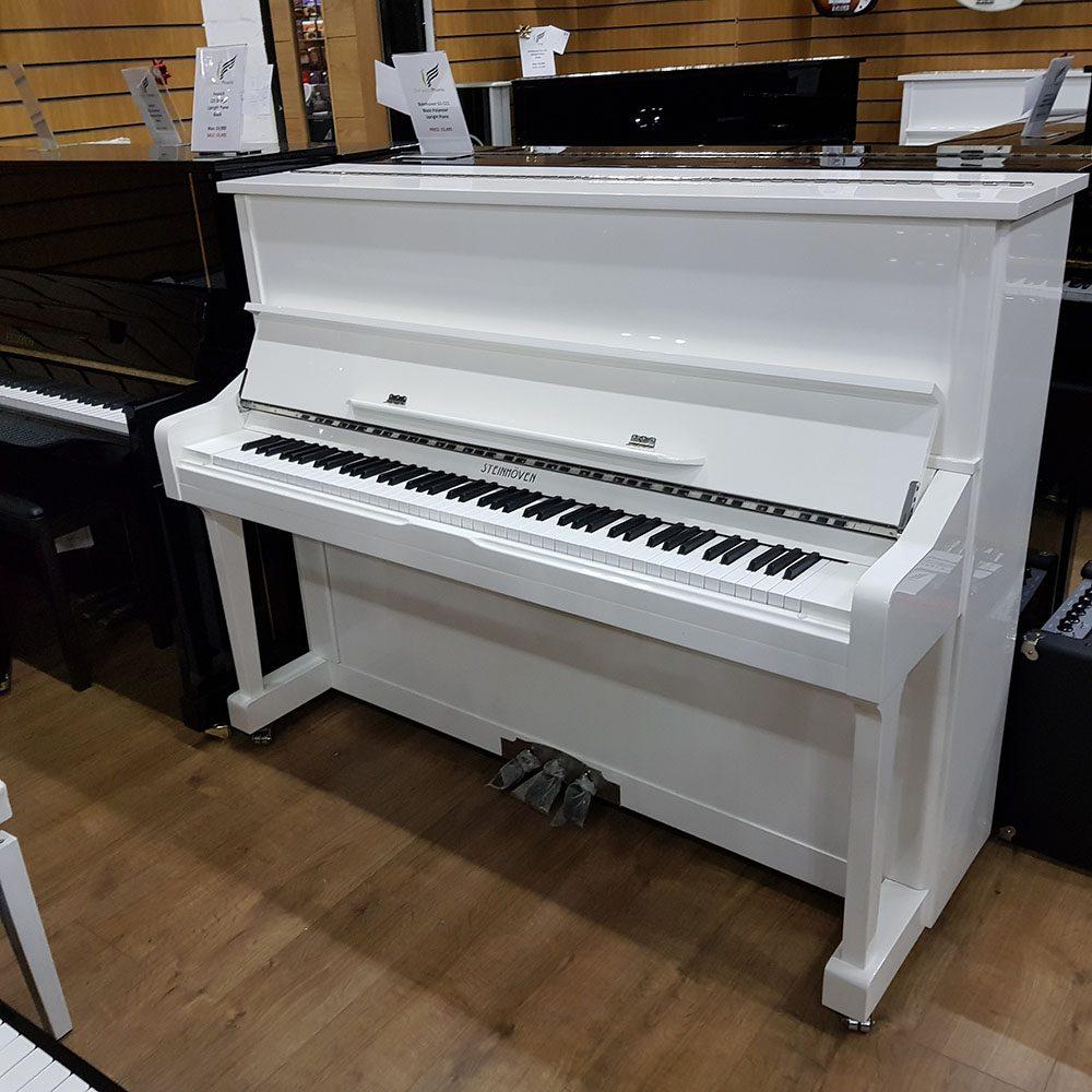 Steinhoven SU-121 upright piano for sale, in a white polyester case.