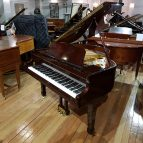 Used Cranes CJS-142 baby grand piano, in a mahogany case, for sale.