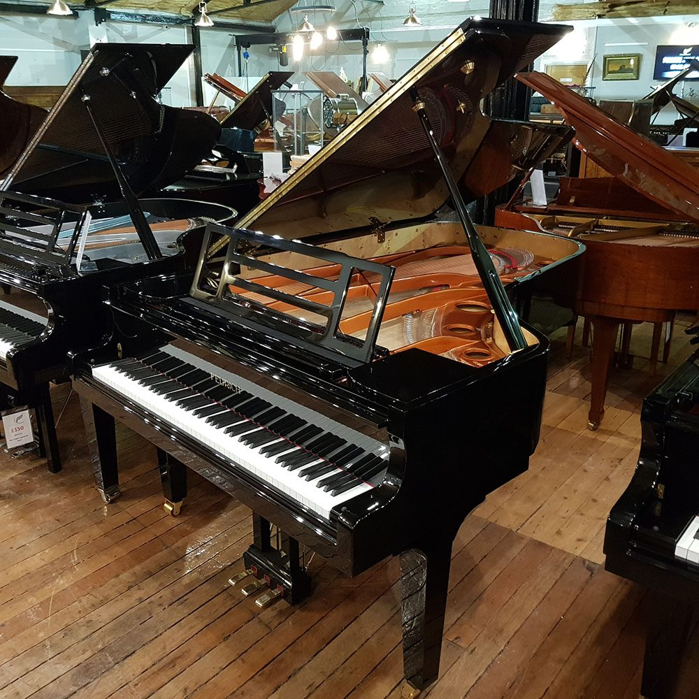Feurich 218 Concert I grand piano for sale, in a black polyester case.