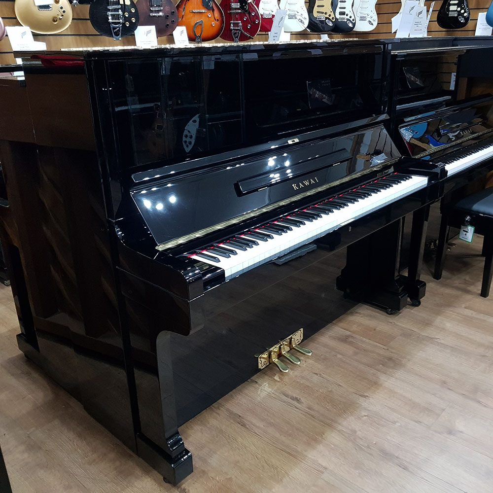 Used Kawai KS-5F upright piano for sale, in a black polyester case.