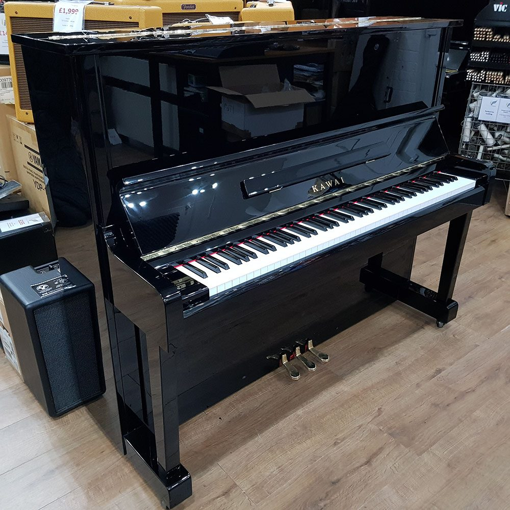 Used Kawai NS-10 upright piano for sale, in a black polyester case.